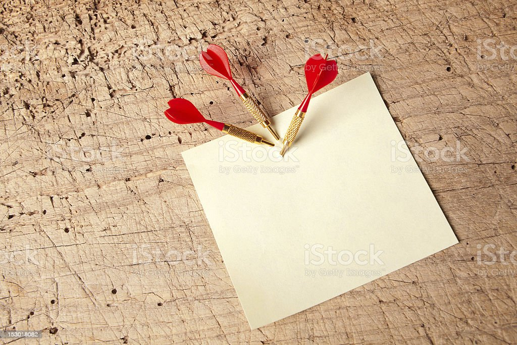 Red darts in a notepad royalty-free stock photo