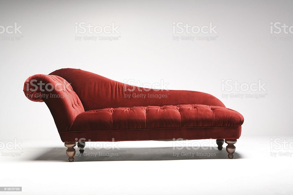 Red daybed in white studio stock photo