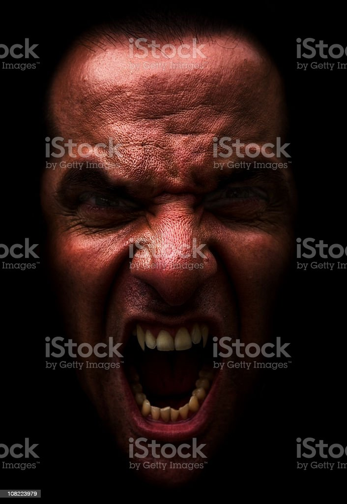 Red Demon Man Snarling and Showing Fangs royalty-free stock photo