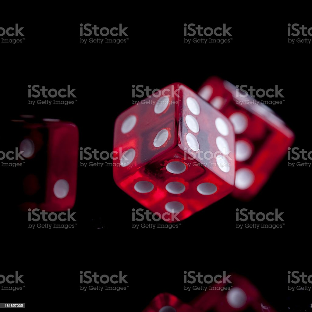 Red Dice against black background stock photo