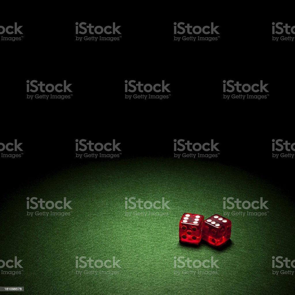 Red Dice against green background royalty-free stock photo
