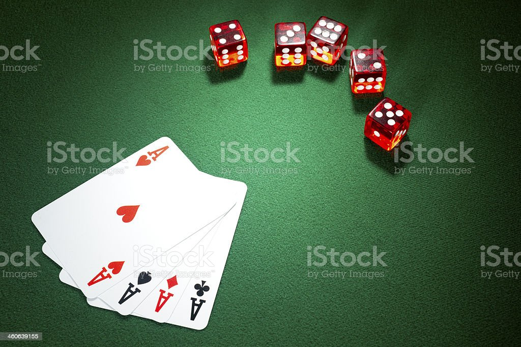 Red dice, four aces  on a green felt royalty-free stock photo