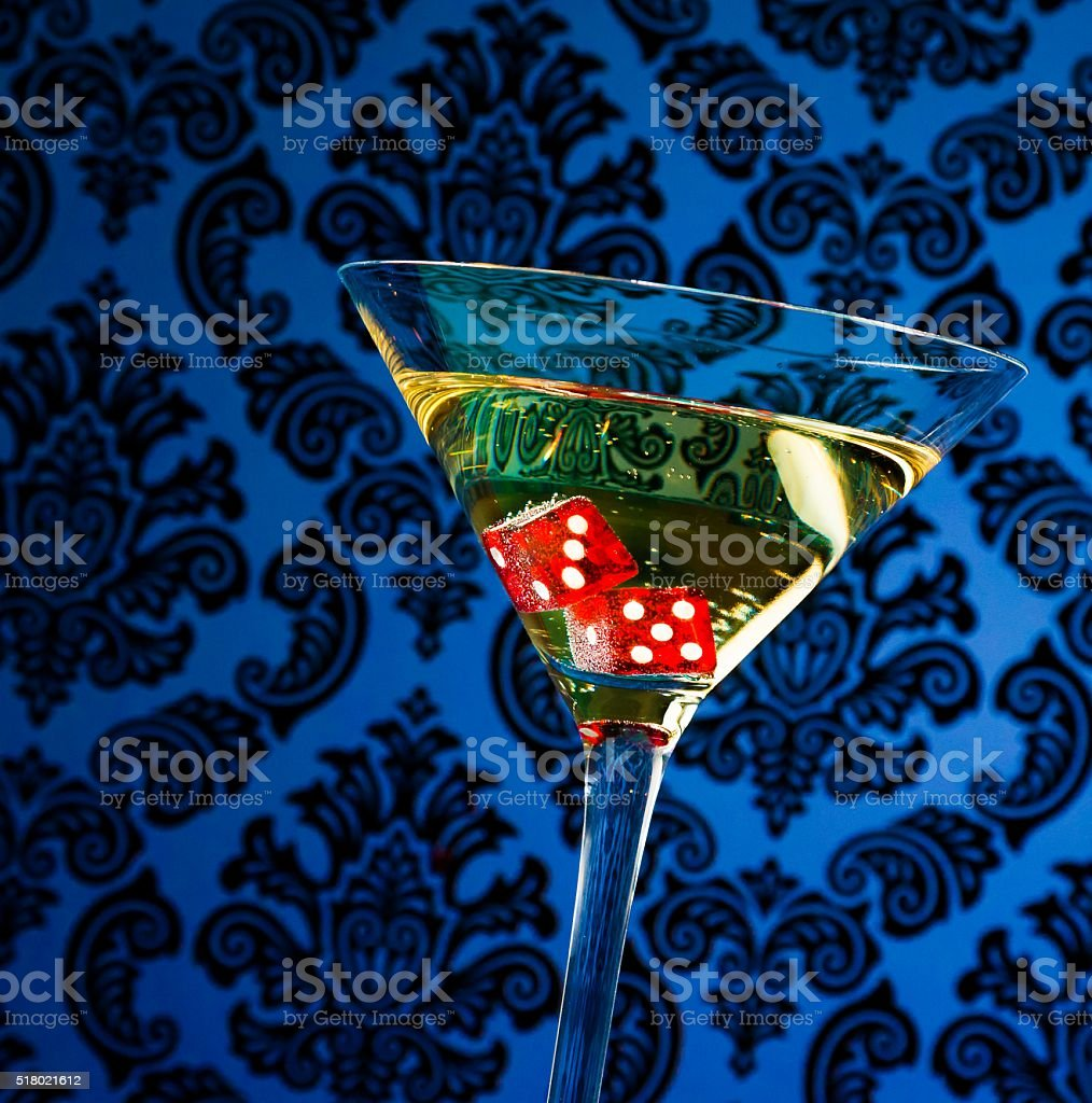 red dice in the cocktail glass stock photo