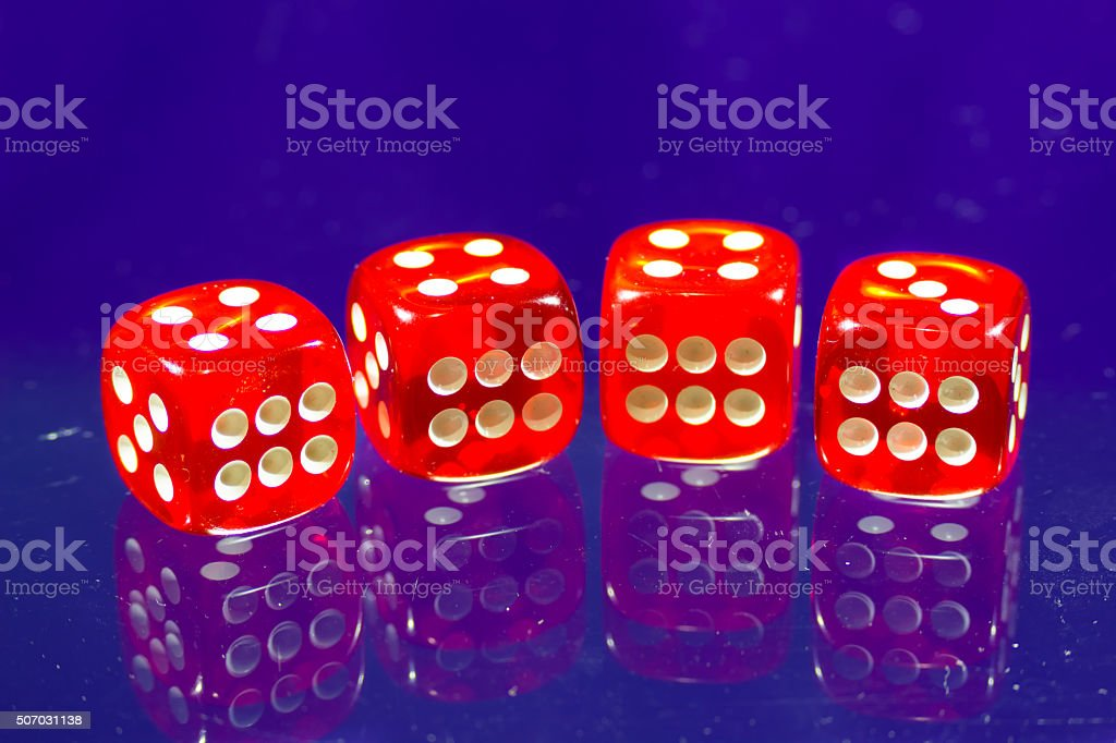 Red dice near a camera stock photo