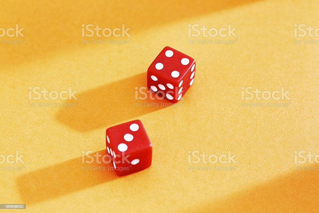 Red dice on yellow background show 7: lucky for some! royalty-free stock photo