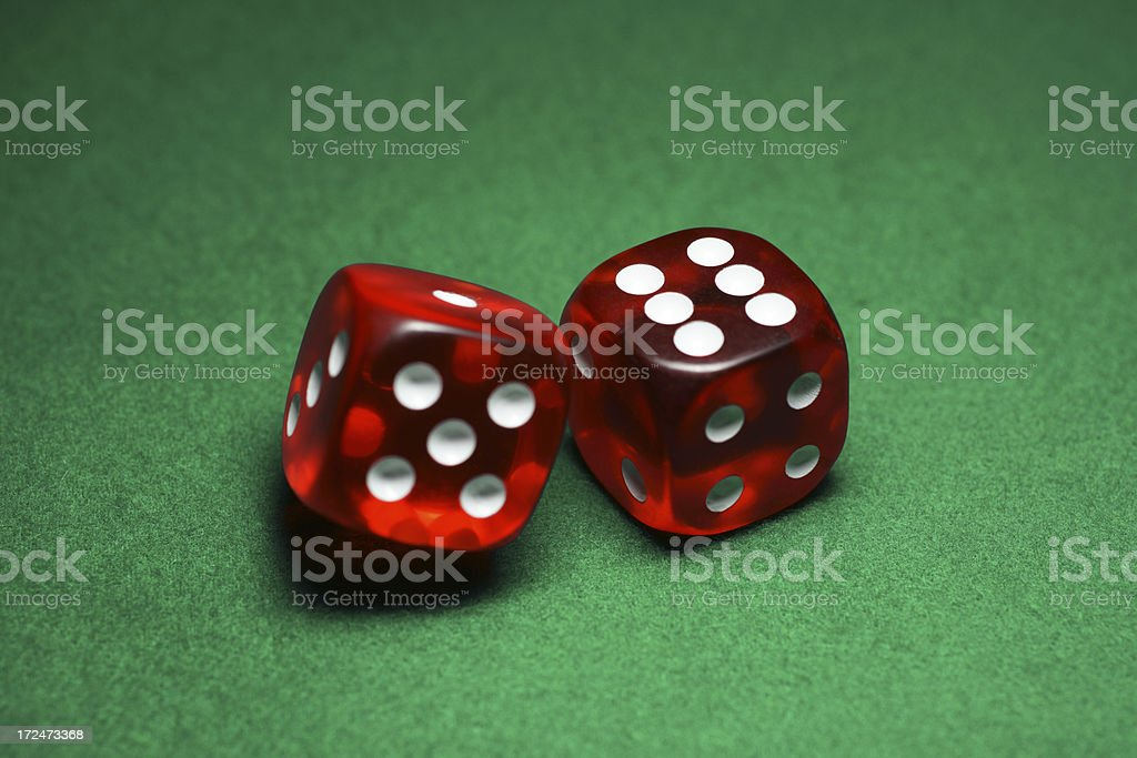 Red Dice Rolling on Green Felt royalty-free stock photo