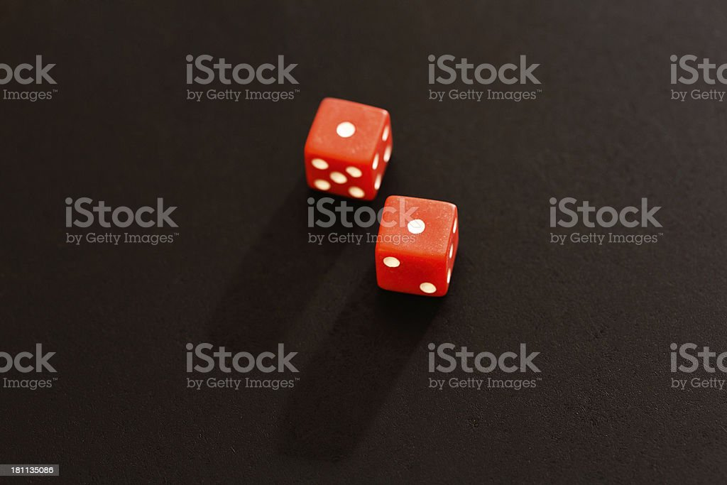 Red dice show 2 or snake eyes on black royalty-free stock photo