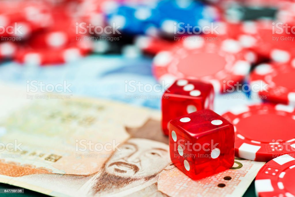 Red dices and korean currency on the table stock photo