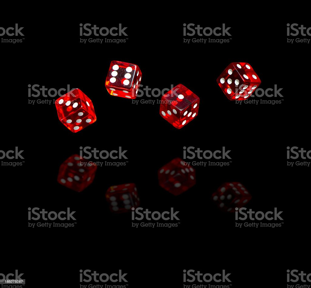 Red dices on black background stock photo