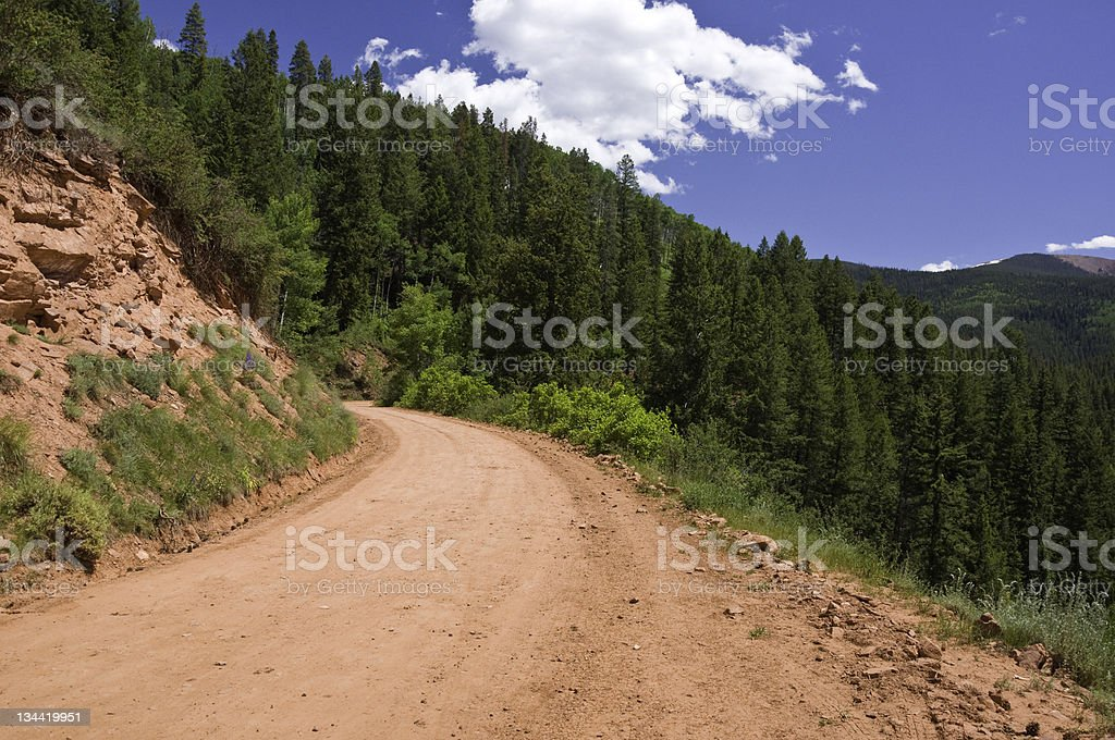 Red Dirt Road in Mountain Forest royalty-free stock photo