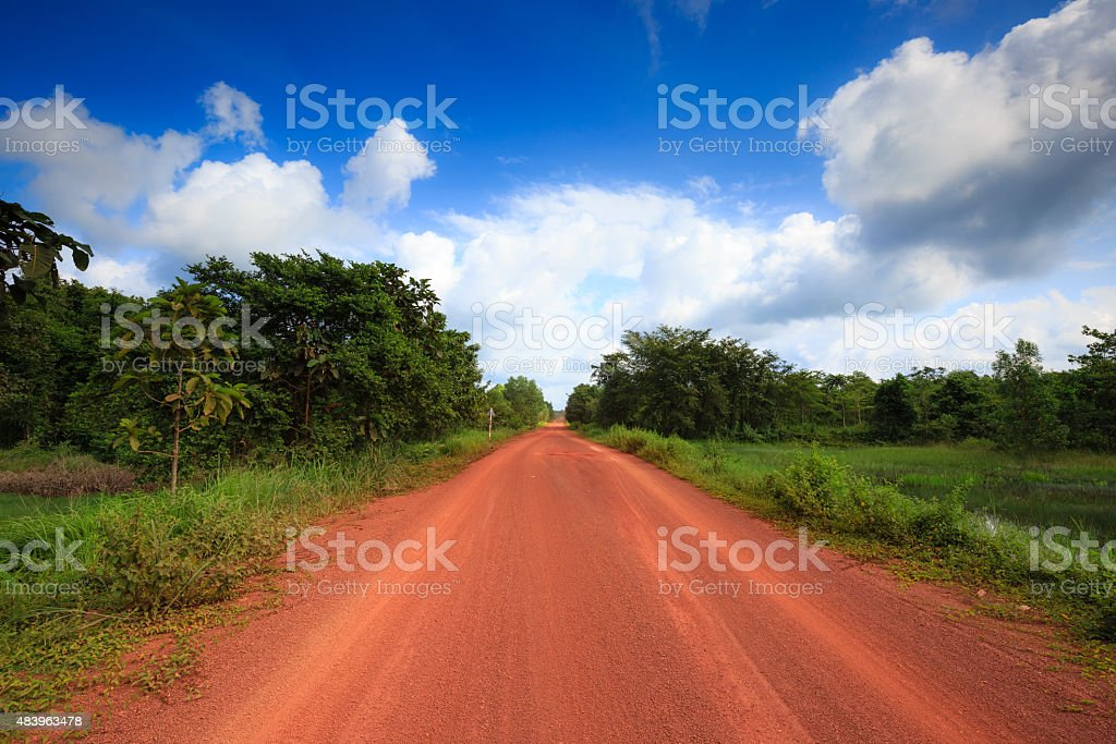 Red dirt road in the tropical jungle stock photo