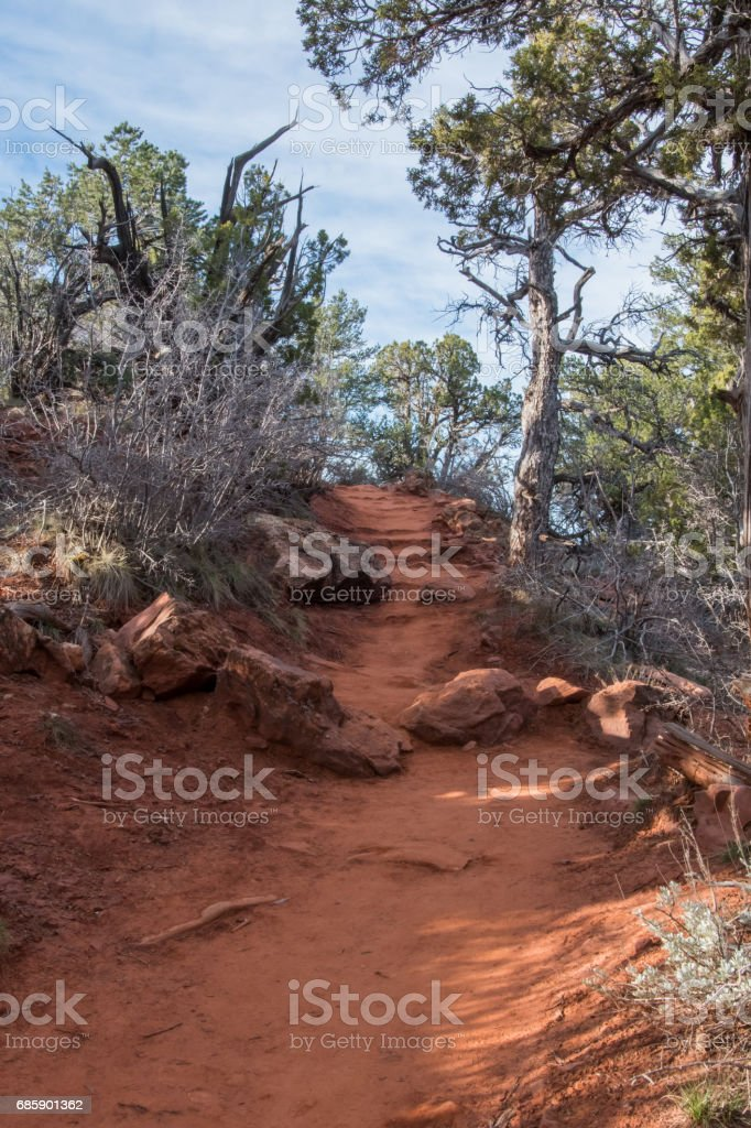 Red Dirt Trail Heading Uphill stock photo