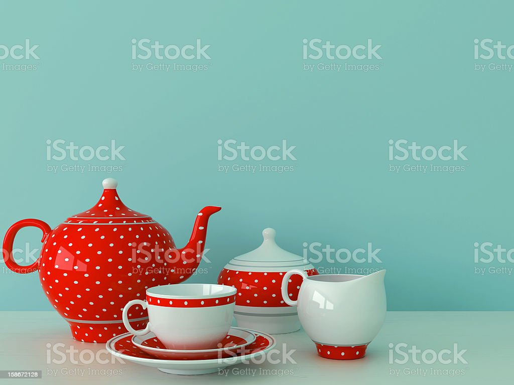 Red dishware on a blue background stock photo