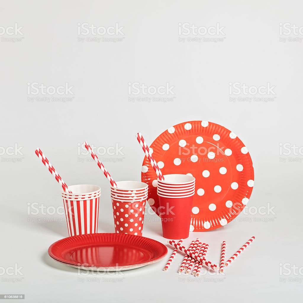 Red disposable tableware for parties and picnics. stock photo