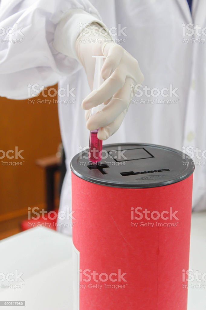 red disposal boxes stock photo