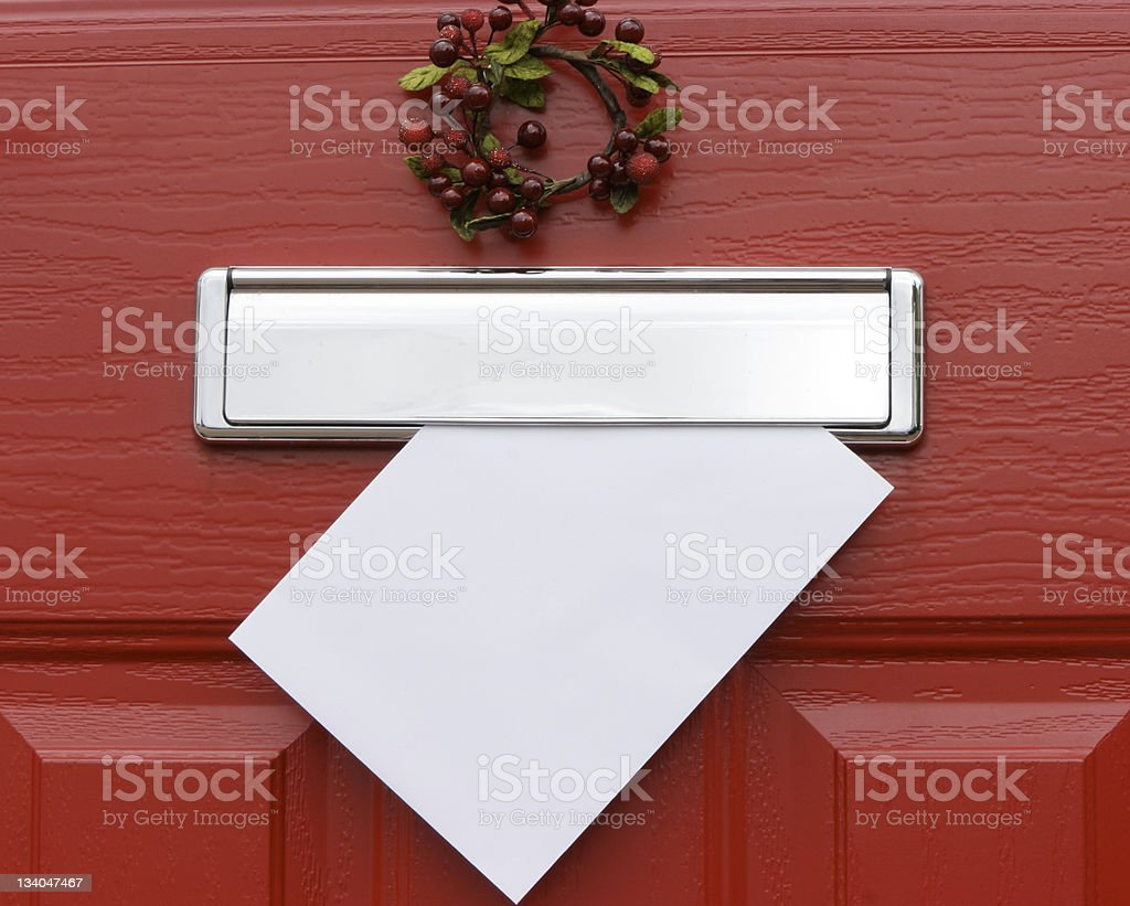 Red door, Christmas letter. stock photo
