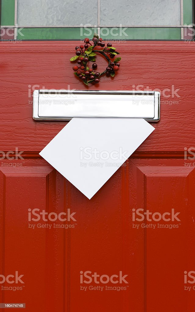 Red door, Christmas post mail letter. stock photo
