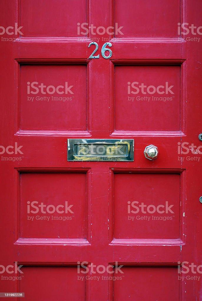 Red door number 26 stock photo