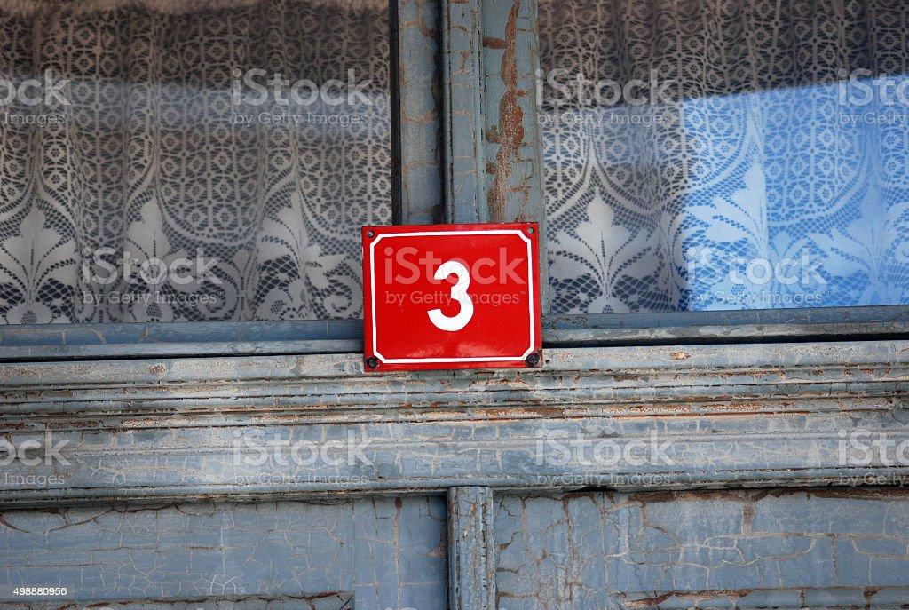 Red door number 3 stock photo