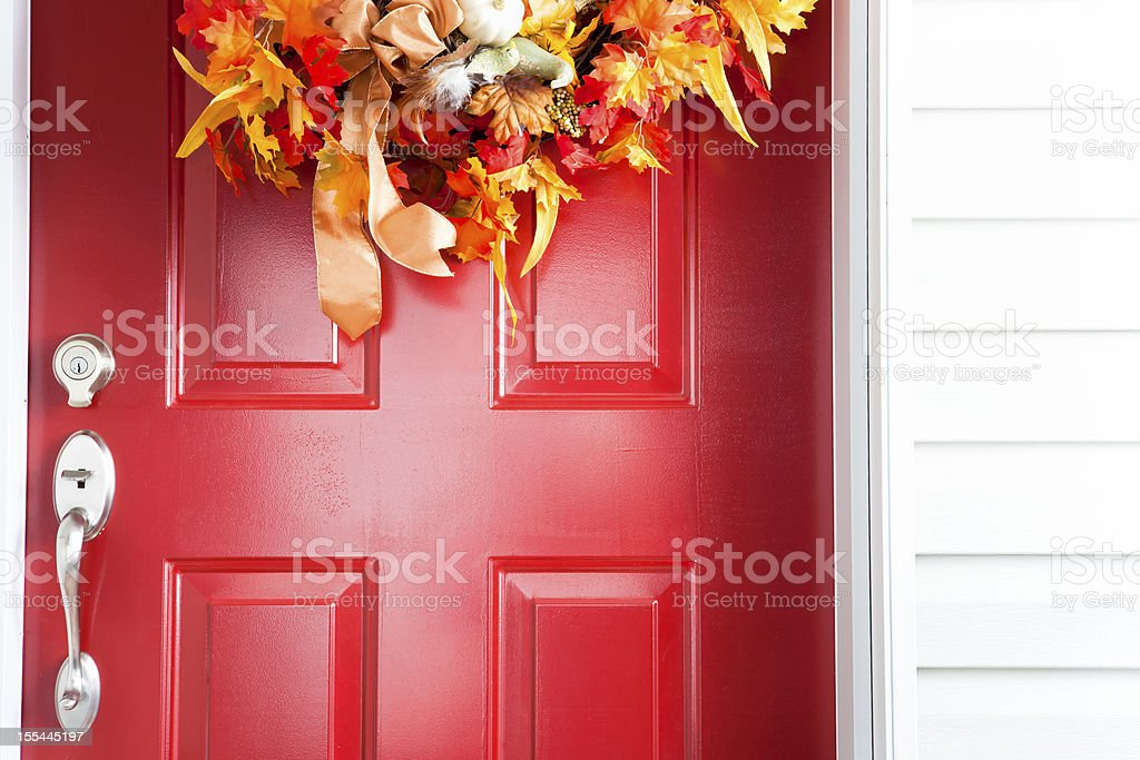 Red door with autumn wreath royalty-free stock photo