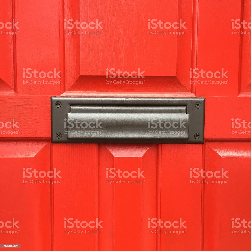Red Door with Mail Slot stock photo