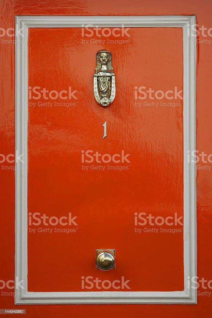 Red doors with door knocker royalty-free stock photo