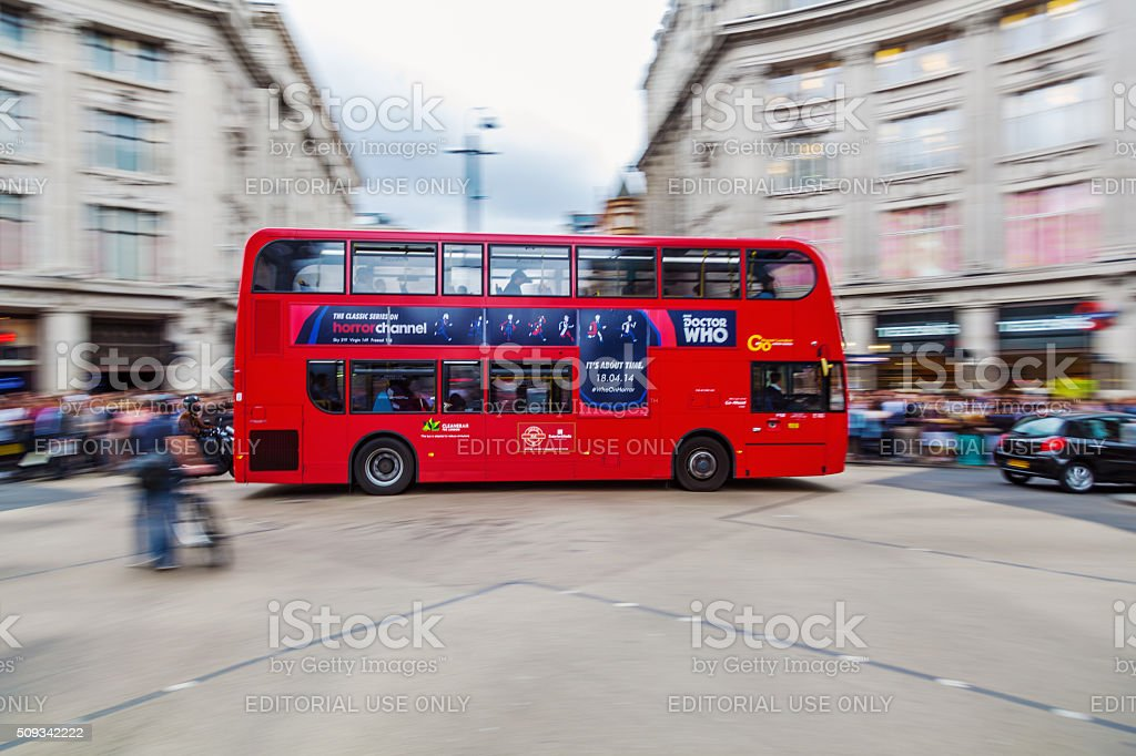 red double decker bus in London in motion blur stock photo
