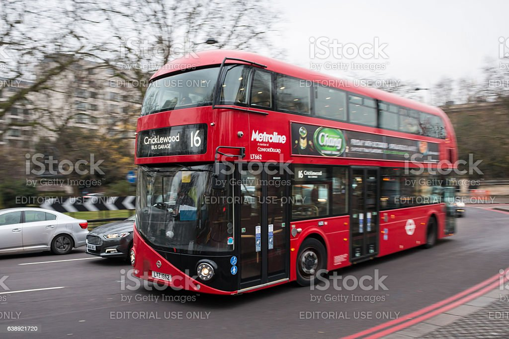 Red double decker bus in motion stock photo