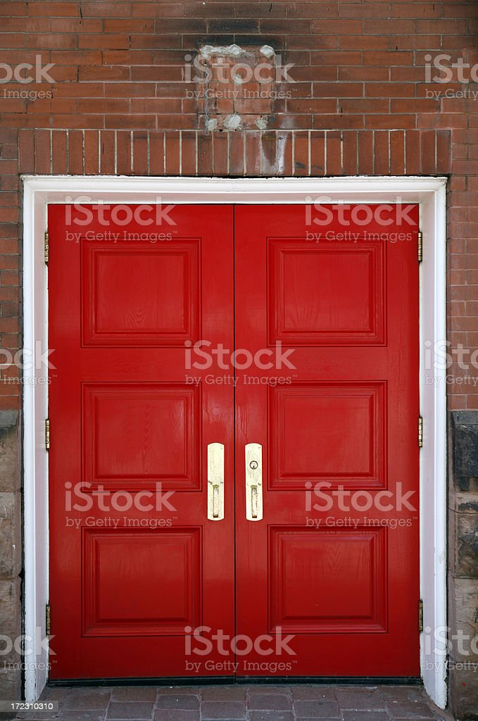 Red Double Door With Brass Handles and White Frame stock photo