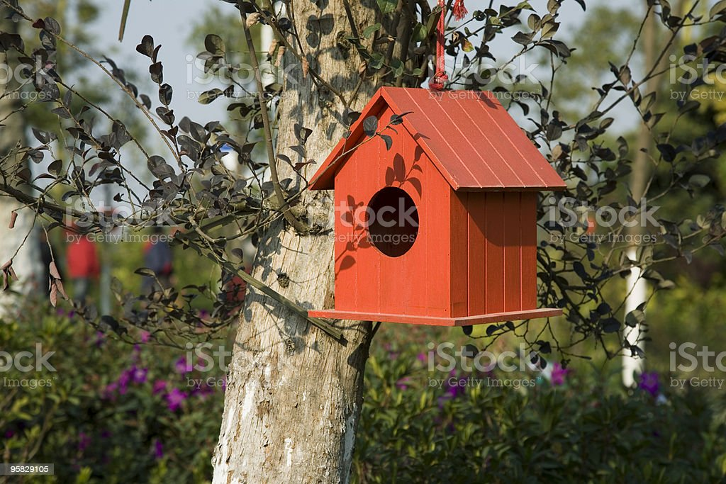 Red dovecote in the forest royalty-free stock photo