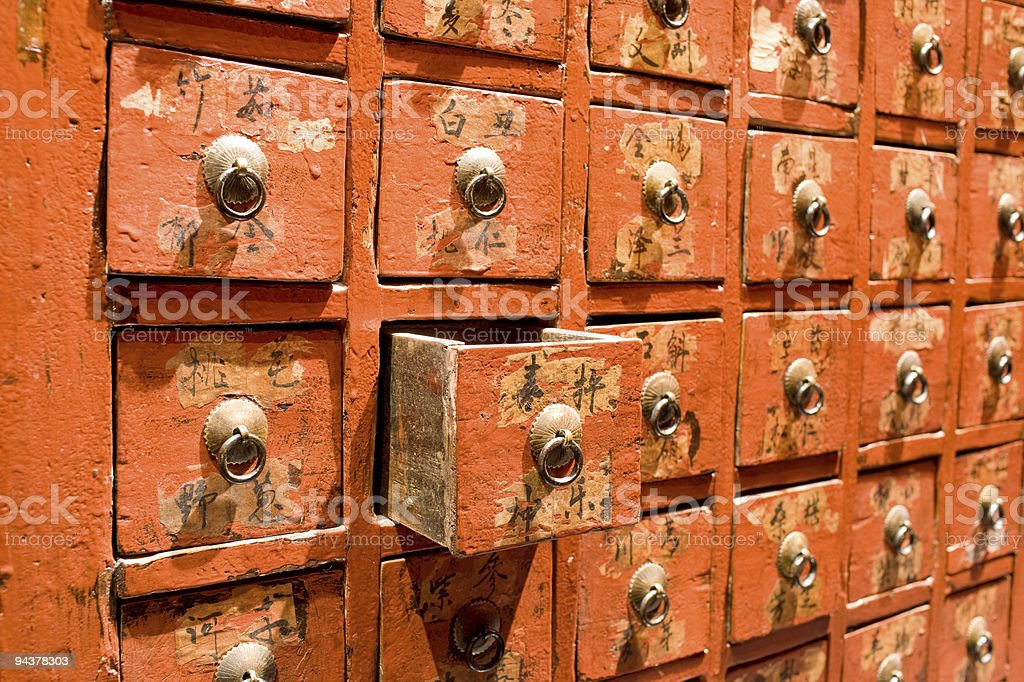 Red drawer of old fashioned chinese cabinet stock photo