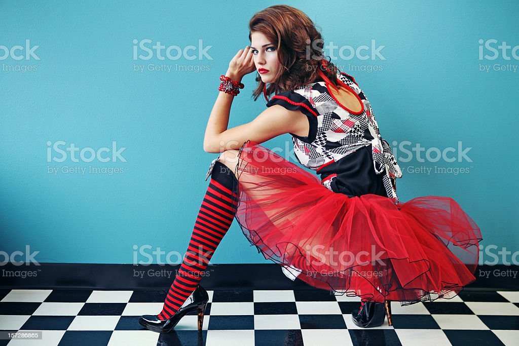 Red Dress and Stocking Girl on Checkered Tile Floor royalty-free stock photo