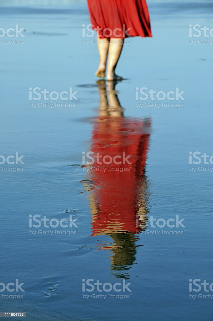Red Dress Woman Reflected on Beach royalty-free stock photo