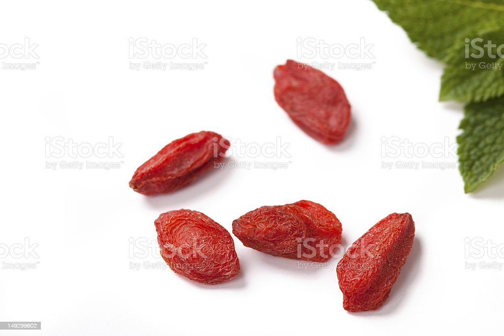 red dried goji berries on white, close up royalty-free stock photo
