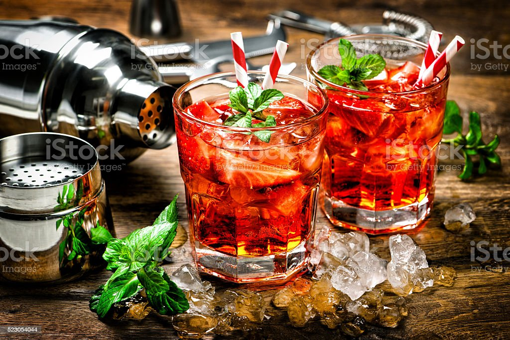Red drink. Cocktail making bar accessories vintage stock photo