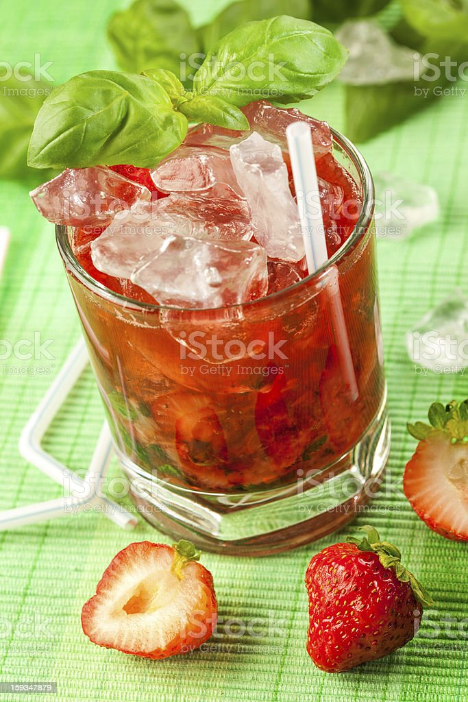 Red drink on a green background and ice stock photo