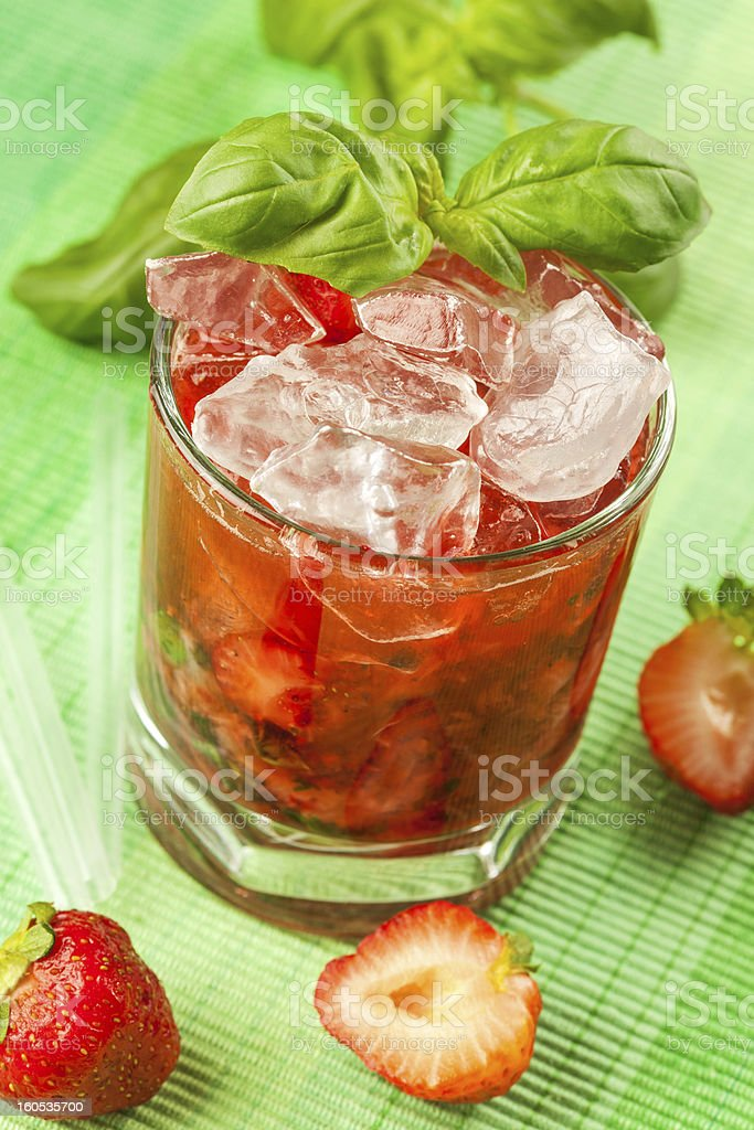 Red drink on a green background stock photo