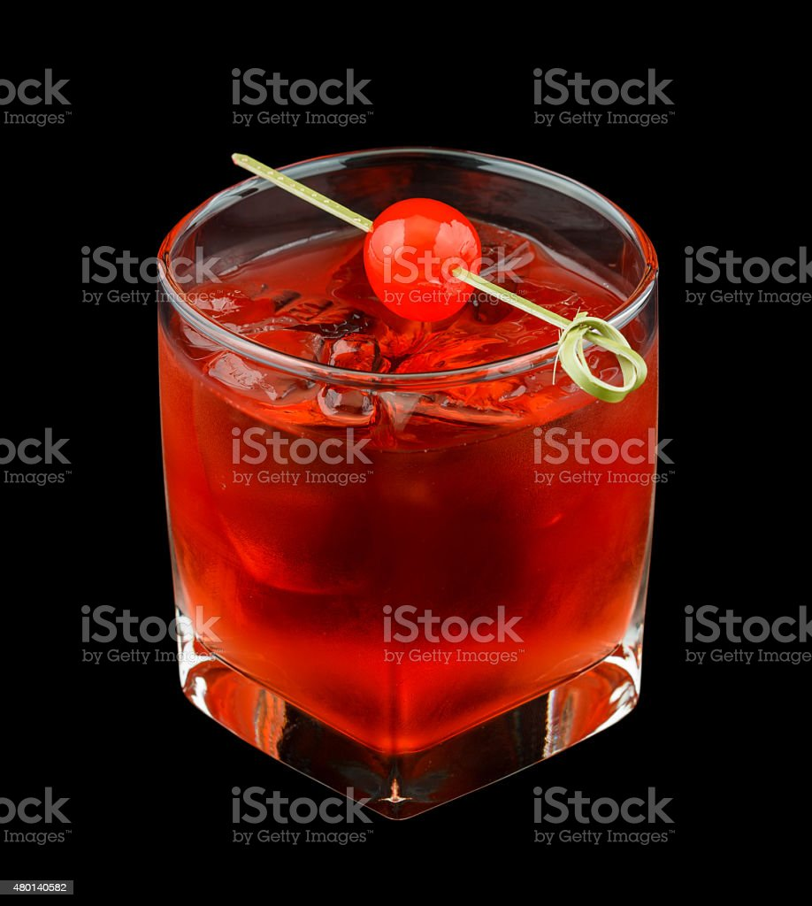 Red drink with a maraschino cherry isolated on black stock photo