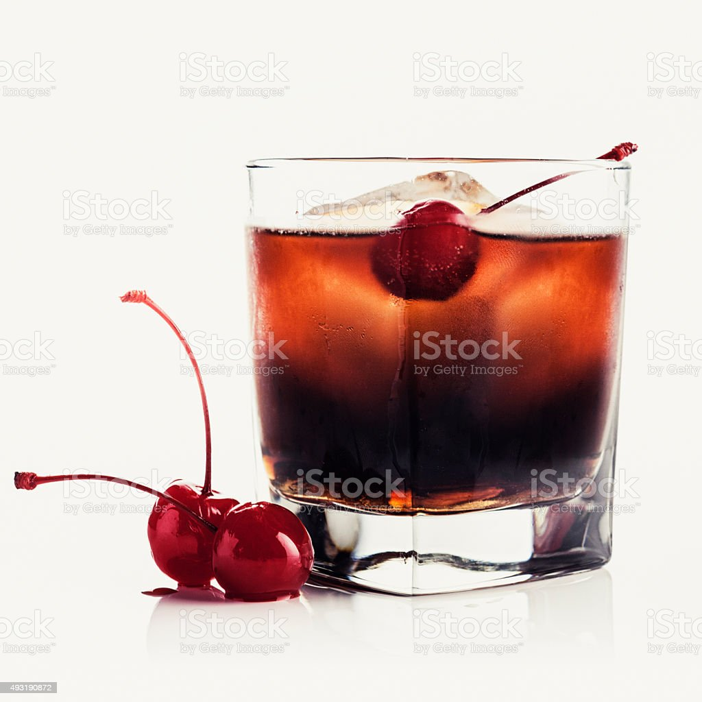Red drink with a maraschino cherry stock photo
