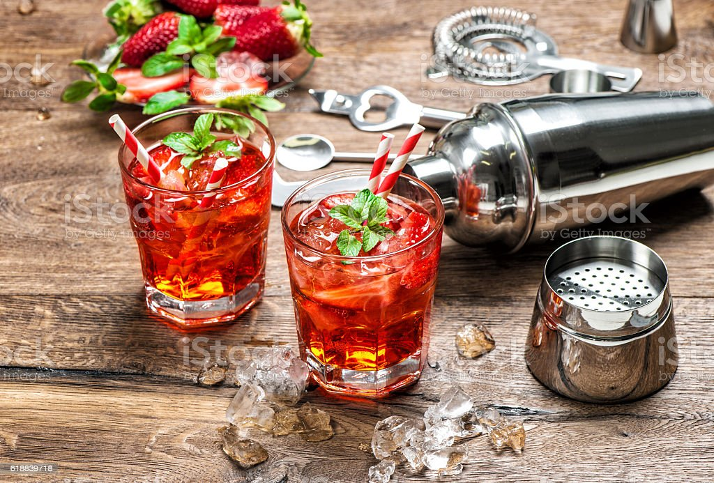 Red drink with ice. Aperitif, mojito, caipirinha, juice, cocktail stock photo