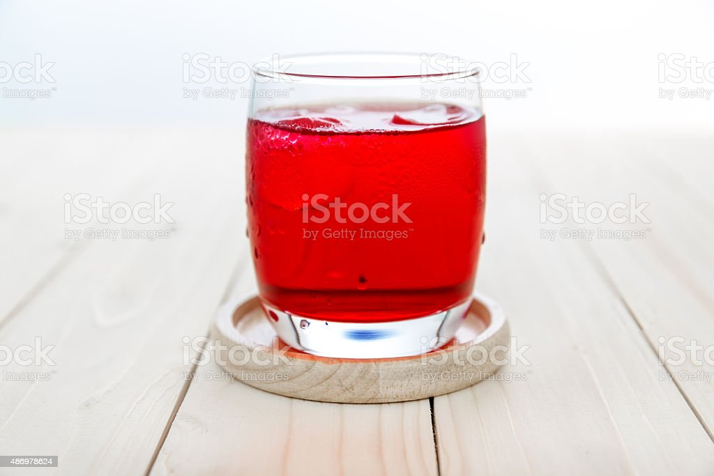 Red drink with ice cubes in a glass stock photo