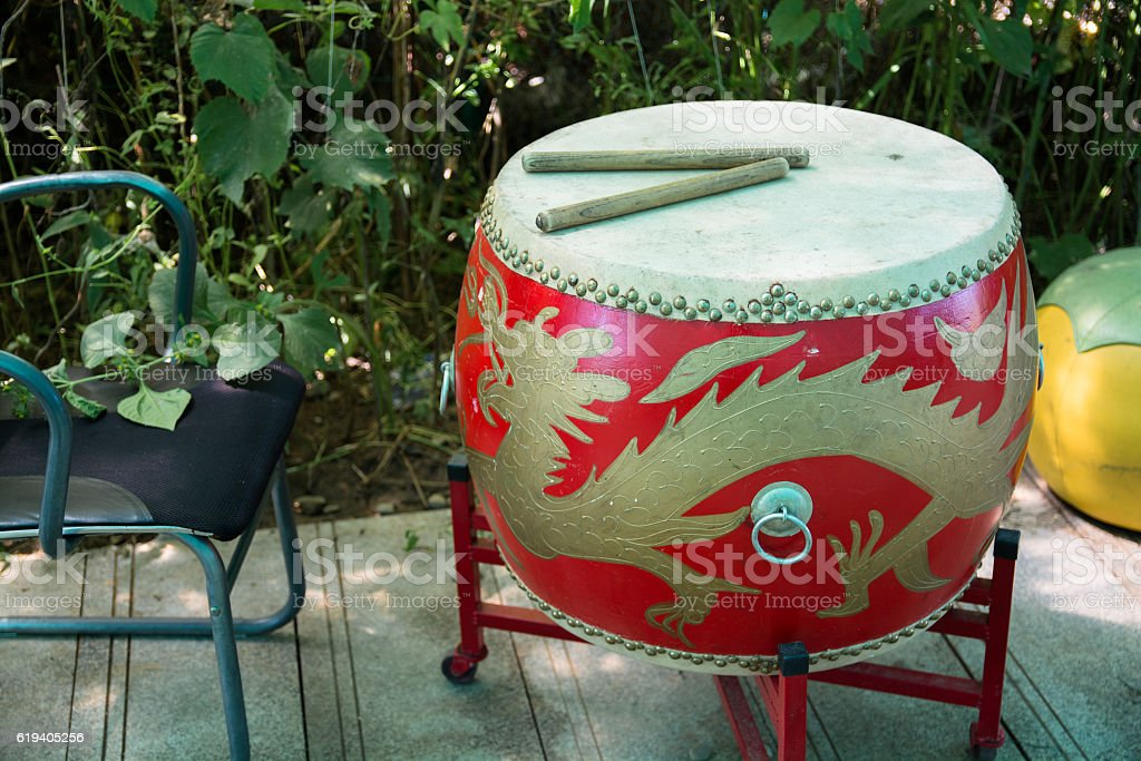 Red drum with asian motifs on the base. stock photo