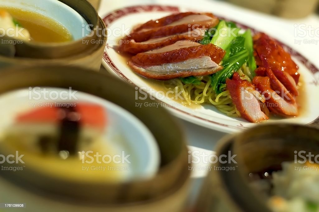 Red Duck with noodles - Dim Sum in tilt view royalty-free stock photo