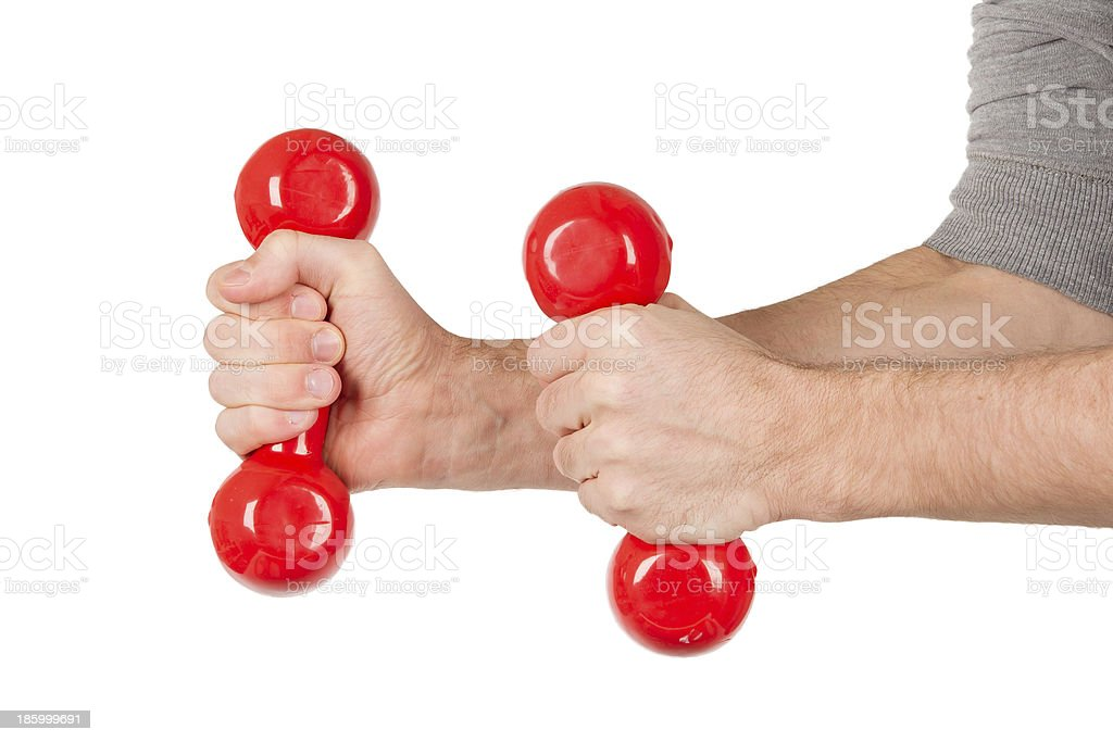 Red dumbbells in the hands of a man, isolated royalty-free stock photo