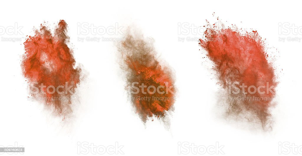 Red dust explosion isolated on white background stock photo