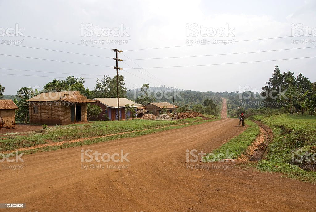 Red dusty dirt road stock photo