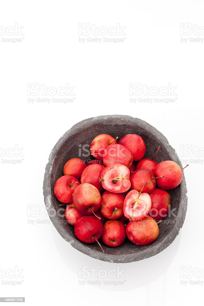 Red dwarf apples in bowl, white background stock photo