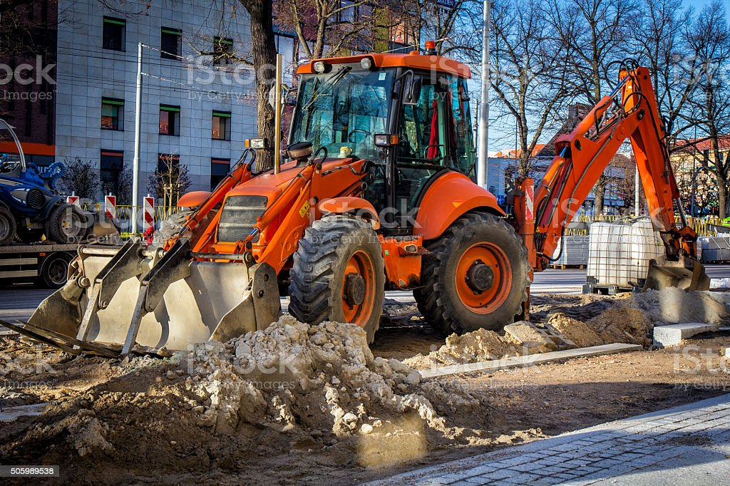 Red earth mover in a new road construction stock photo