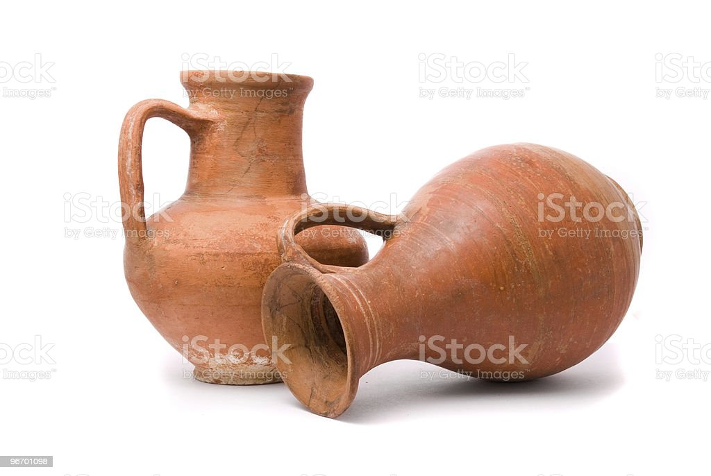 Red earthenware jugs standing upright and laying sideways stock photo