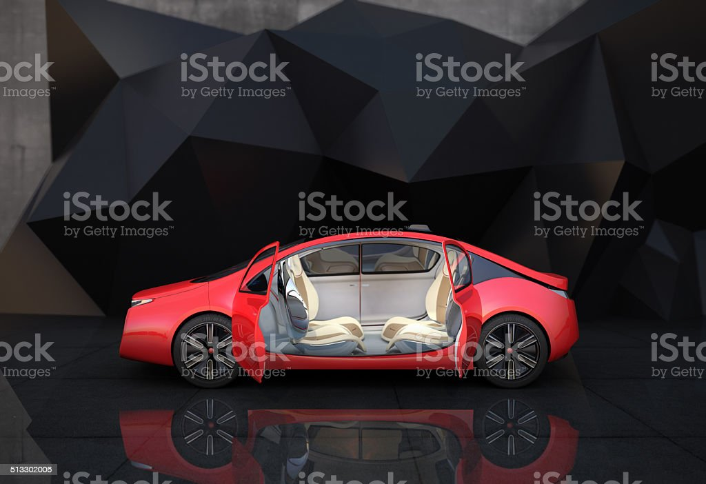 Red electric car in front of geometric object background. stock photo